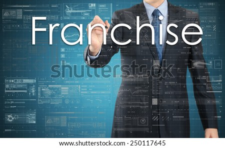 Businessman writing Franchise on virtual screen  - stock photo