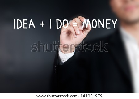 Businessman writing money concept on whiteboard - stock photo