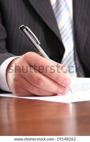businessman writing on a form - stock photo