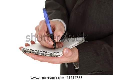 Businessman writing on a notepad taking notes and planning in a meeting isolated on white with copyspace - stock photo