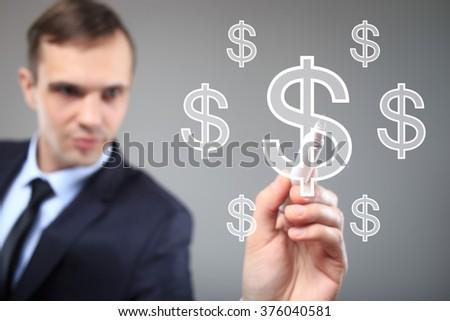 Businessman writing on screen with virtual background. dollar icon