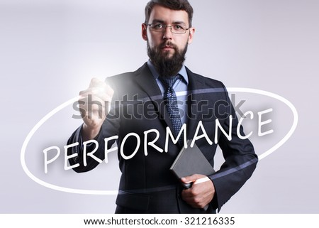 """Businessman writing """"Performance"""" with marker on transparent board. - stock photo"""