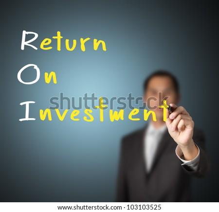 businessman writing return on investment ( ROI ) concept on whiteboard - stock photo