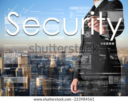 businessman writing Security on transparent board with city in background - stock photo