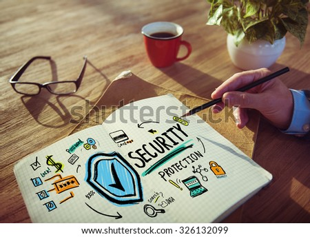 Businessman Writing Security Protection Planning Concept - stock photo