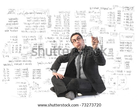 Businessman writing some complicated graphics - stock photo