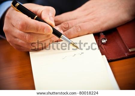 Businessman writing some documents, closeup - stock photo