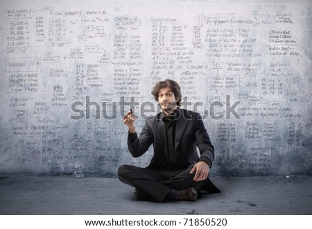 Businessman writing some statistics - stock photo