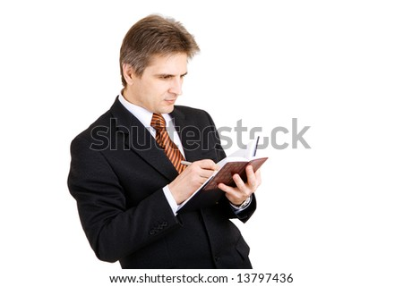 businessman writing something in his notebook - stock photo