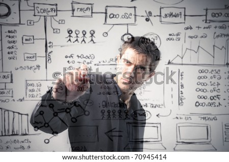 Businessman writing statistics