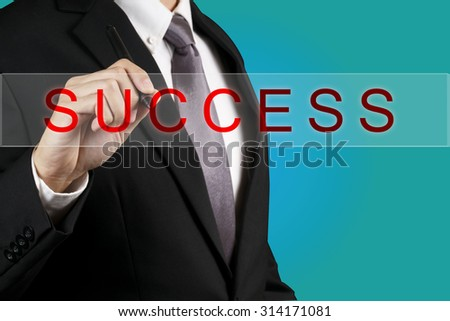 Businessman writing Success word