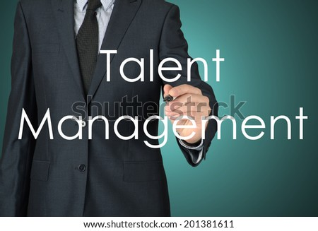 businessman writing talent management - stock photo