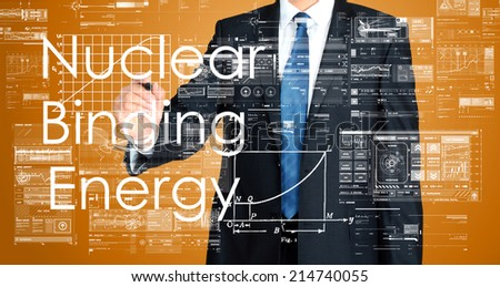 businessman writing technological terminology on virtual screen with modern business or technology background - Nuclear Binding Energy  - stock photo