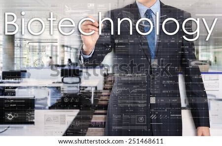 businessman writing technological terminology on virtual screen with modern business or technology background - Biotechnology - stock photo