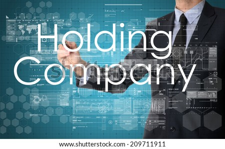 businessman writing technology terminology on virtual screen with business or technology background - holding company - stock photo