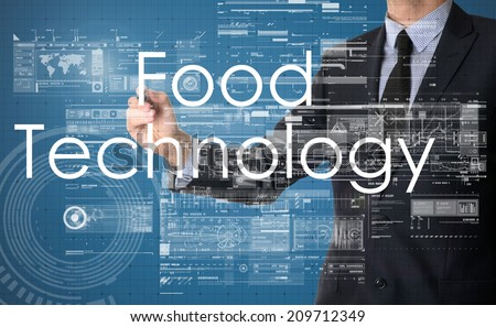 businessman writing technology terminology on virtual screen with business or technology background - food technology - stock photo