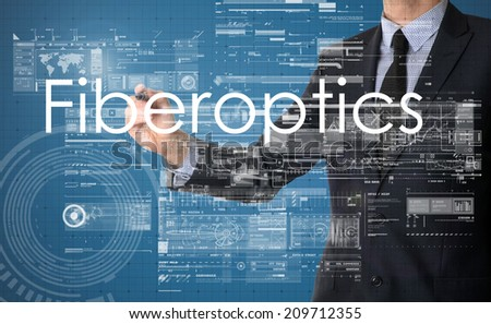 businessman writing technology terminology on virtual screen with business or technology background - fiberoptics - stock photo