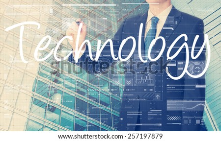 businessman writing Technology with some modern pattern in background - stock photo