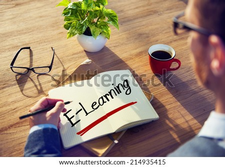Businessman Writing the Word E-Learning - stock photo