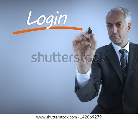 Businessman writing the word login with a marker - stock photo