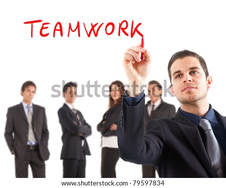 "Businessman writing the word ""teamwork"" on the screen - stock photo"