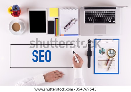 Businessman Writing the Words SEO Concept - stock photo