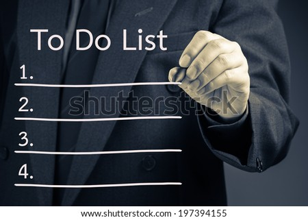 Businessman writing To Do List procedure concept on screen - stock photo