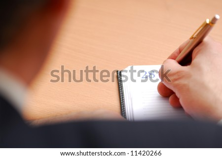 businessman writing to the organizer