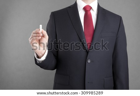 Businessman writing with chalk. You can add your own text.  - stock photo