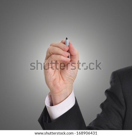 Businessman writing with marker isolated on gray background. Plenty of room for a message. - stock photo