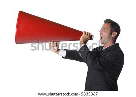 Businessman yelling through megaphone - stock photo