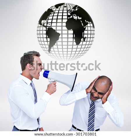 Businessman yelling with a megaphone at his colleague against grey background - stock photo