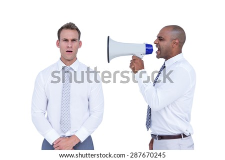 Businessman yelling with a megaphone at his colleague on white background - stock photo