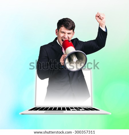 Businessman yelling with a megaphone on green background