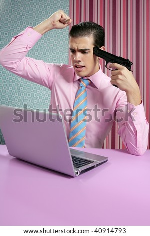 businessman young shooting handgun with computer pink background - stock photo