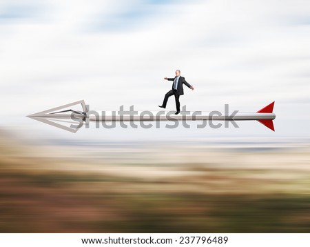 businessmanon fast metal 3d arrow - stock photo