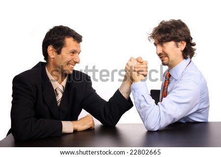 businessmans arm wrestling over white background - stock photo
