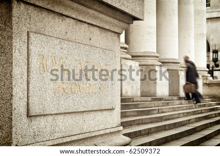 Businessmans entering into Royal Exchange building. - stock photo