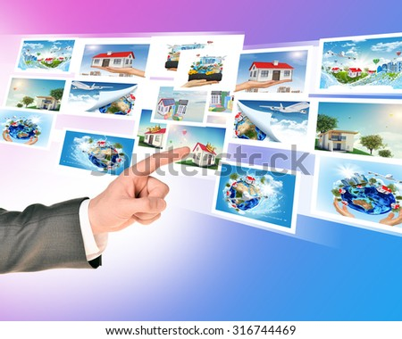 Businessmans finger touching holographic pictures on abstract background