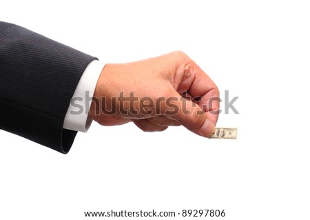 Businessmans hand holding a small hundred dollar bill in his finger tips. Bill is a mini replica of US One Hundred dollar bill. Horizontal format over a white background.