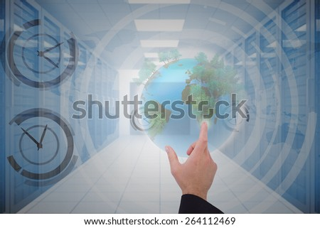 Businessmans hand presenting against server hallway - stock photo