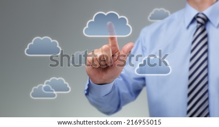 Businessmans hand pressing cloud icon on visual touch screen concept for cloud computing - stock photo