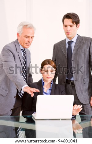 businessmen and businesswoman during a meeting