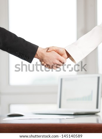 Businessmen and businesswoman shaking hands, isolated on background - stock photo