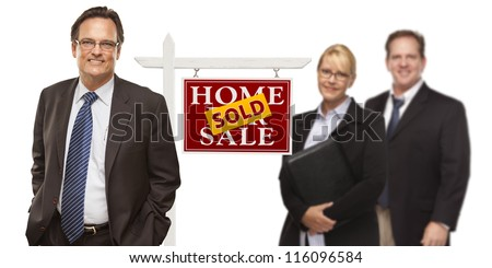 Businessmen and Businesswoman with Sold Home For Sale Real Estate Sign Isolated on a White Background.