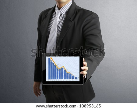 Businessmen, and graph on a tablet