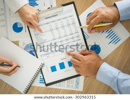Businessmen are analyzing the data to business planning. top view. - stock photo