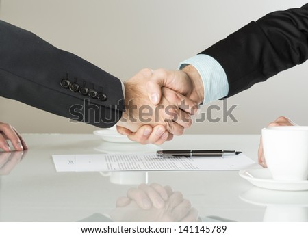 Businessmen are signing a contract, business contract details - stock photo