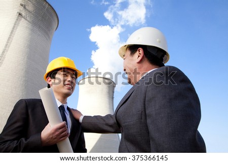 Businessmen at power plant