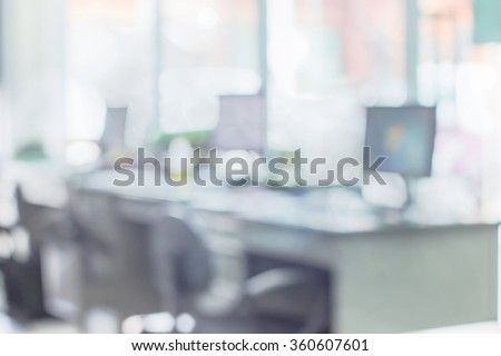 Businessmen blur in the workplace.Table Top And Blur Office of Background.abstract blur background table work in office with computer.Abstract background of office, shallow depth of focus. - stock photo